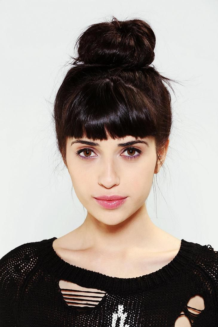 Vanessa Moreira. Long blunt fringe just above eyebrow length. Medium to high forehead, heart or oval shaped face.