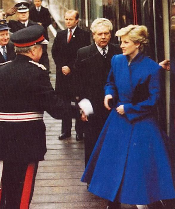 Princess Diana. I've never seen this pic before. She looks gorgeous in that blue coat dress.