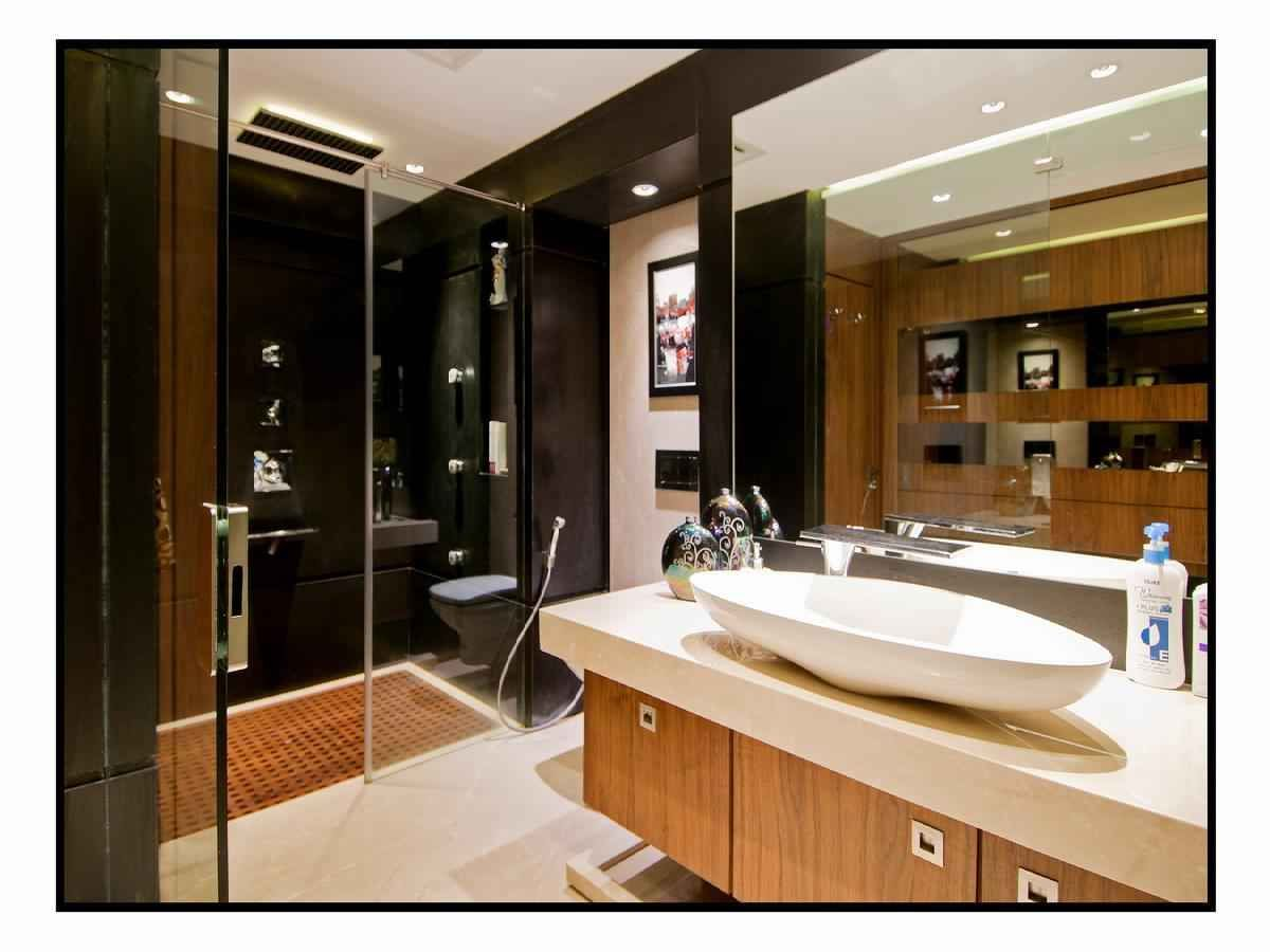 Master bathroom with wash basin cabinet design by architect amit walavalkar adorn space Bathroom design company limited