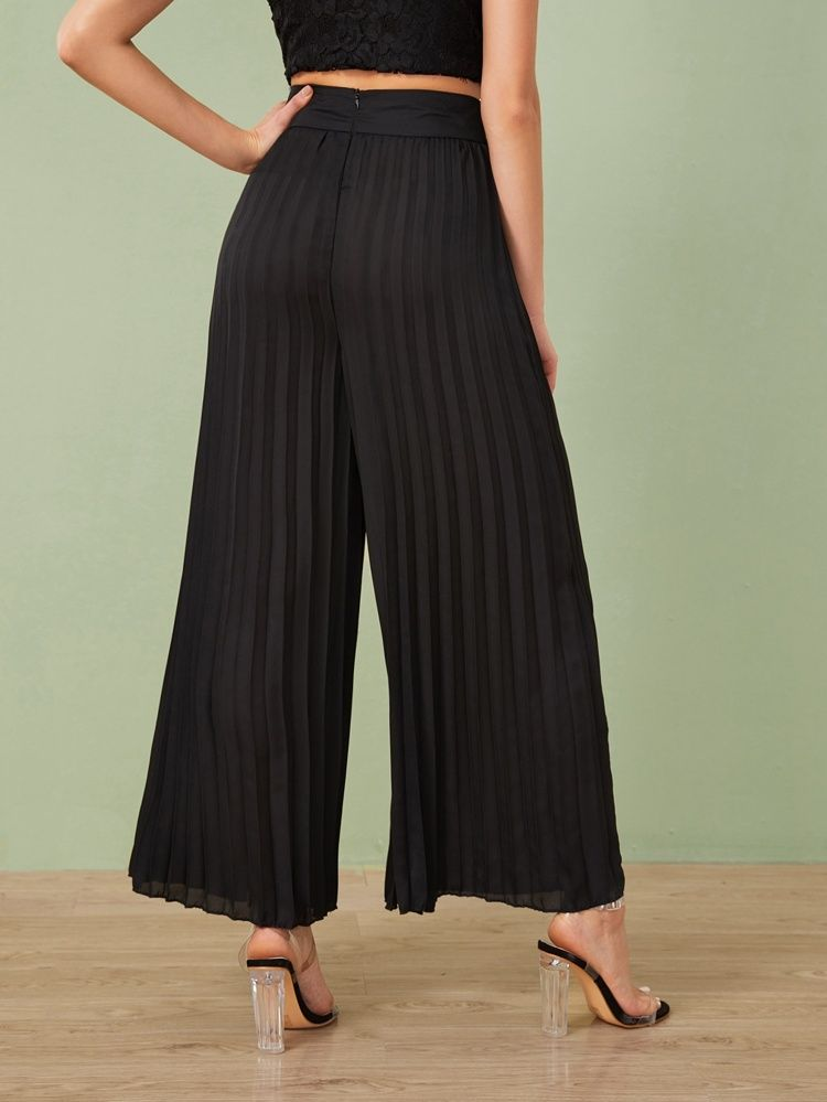 Photo of Pantaloni con spacco laterale con bande