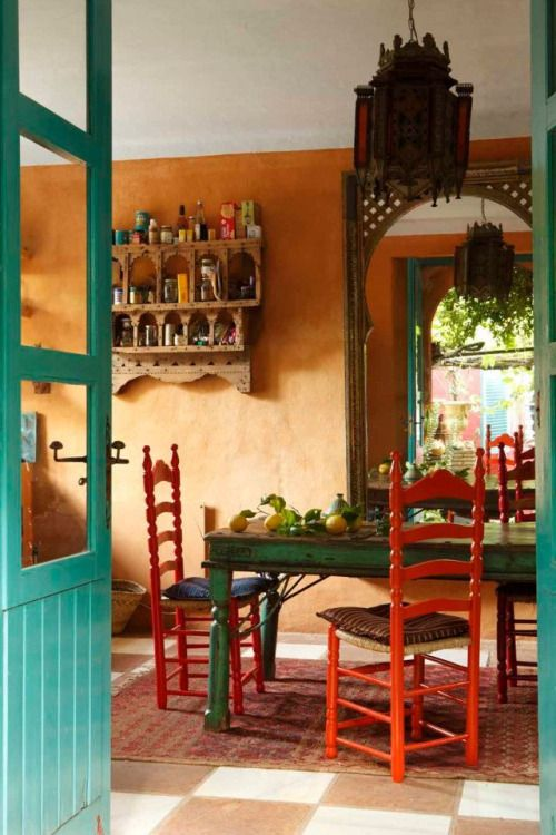 I like the texture of the rusted orange wall the hints of for Spanish style kitchen decor