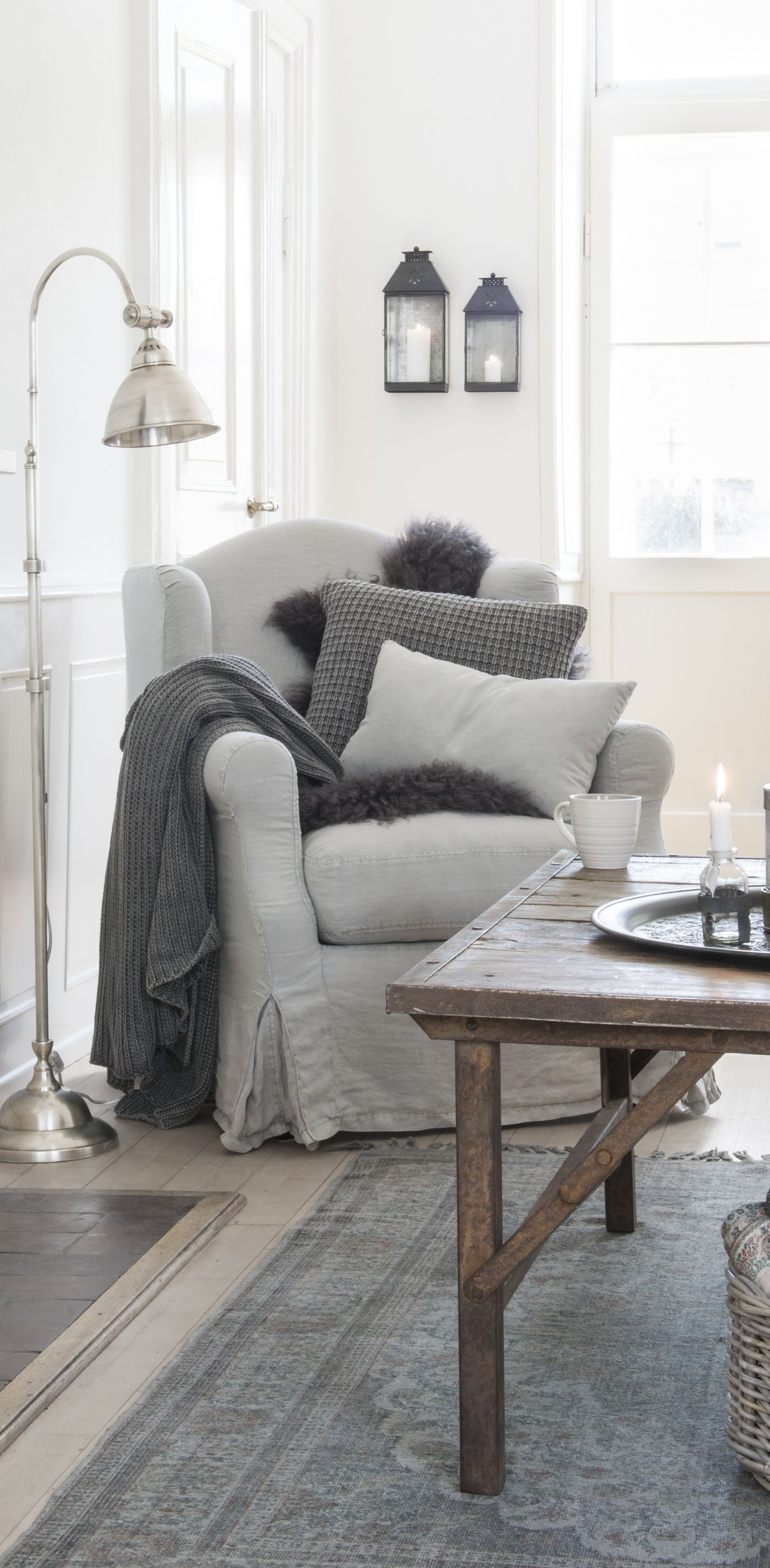 White Sitting Room With Gray Furniture Throw Blankets And Pillows