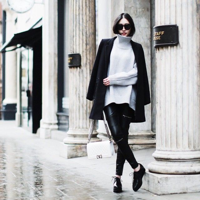Via Just The Design: @allisonmode is dressed in an oversized pale grey turtleneck with leather trousers and a black coat