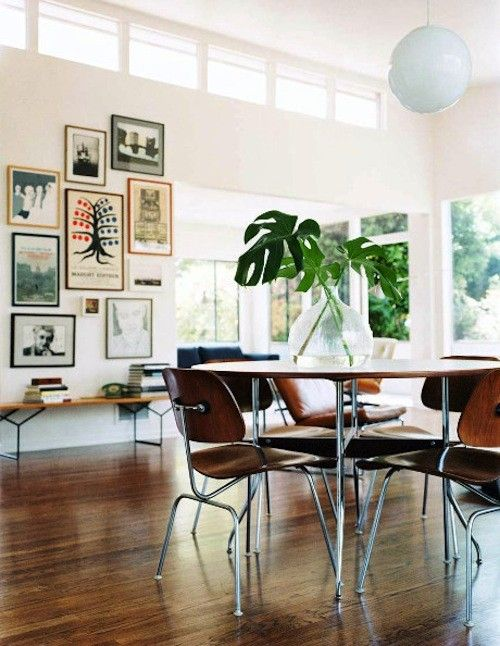 I love the Eames chairs, flooring, art wall, & greenery.