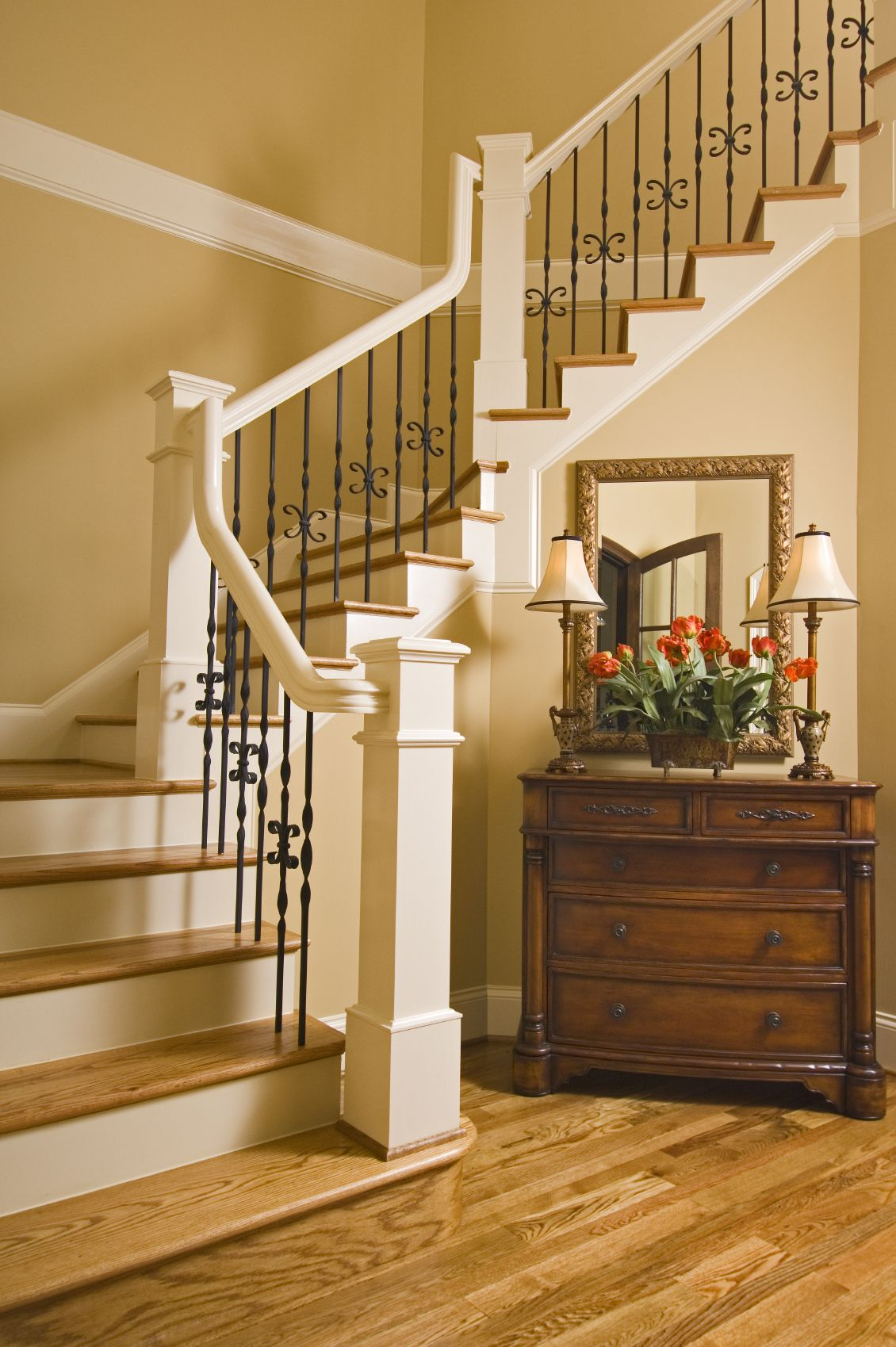 This Contemporary Staircase Has Light Oak Treads And White Railings With  Black Iron Spindles. An Antique Low Dresser Acts As Storage In The Place Of  A ...