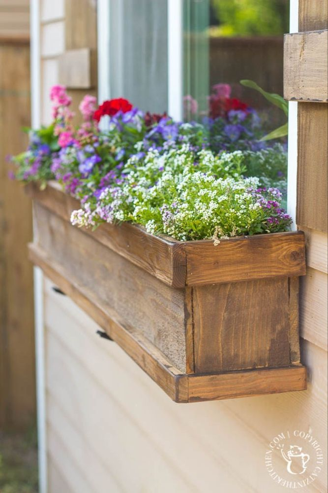 DIY Window Box and Shutters is part of Window boxes diy, Window box flowers, Diy planter box, Window box, Window planters, Window planter boxes - Looking to dress up a plain exterior window  It doesn't get any cheaper, easier, or more flexible than this plan for a DIY Window Box and Shutters!