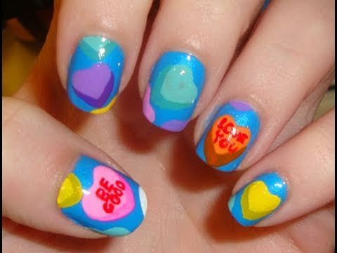 Video tutorial on how to design finger nails for Valentines Day with conversation hearts.