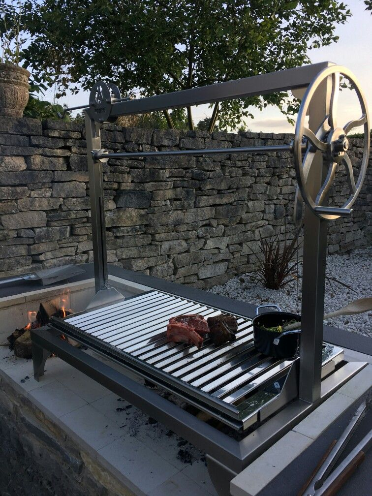 An Asado Grande Parrilla Grill Fitted With A Dutch Oven