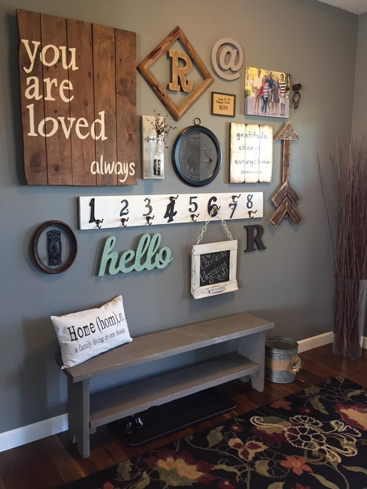 This entry way gallery wall is gorgeous i 39 m loving this - Picture wall ideas for living room ...