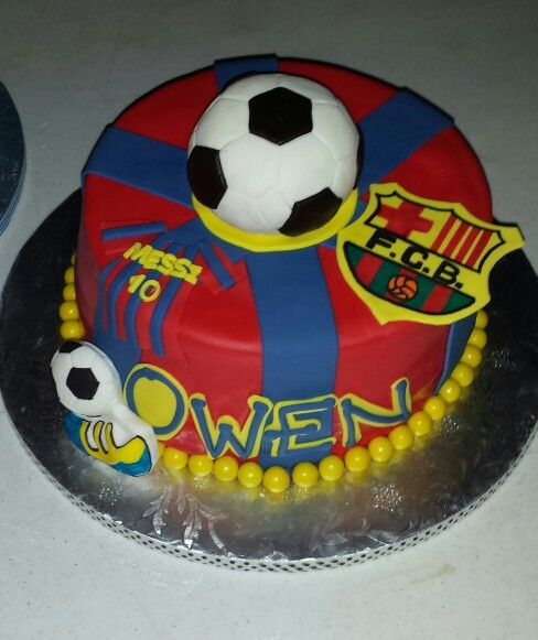 "Barcelona soccer theme birthday cake 9"" fondant covered rice cereal ball, vanilla cake with orange cream filling. 2014"