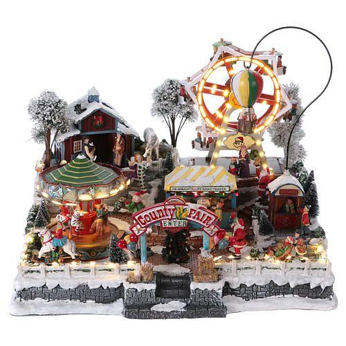 d8d9a8c7504 Escena de Navidad con luces y tren en movimiento 30x30x25 cm Holyart