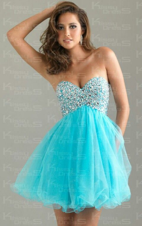 e77a40bc9bf04 Blue prom dress the top has blue and white gems and the bottom of the dress  has light blue flare and ruffels this is a fit and flare dress