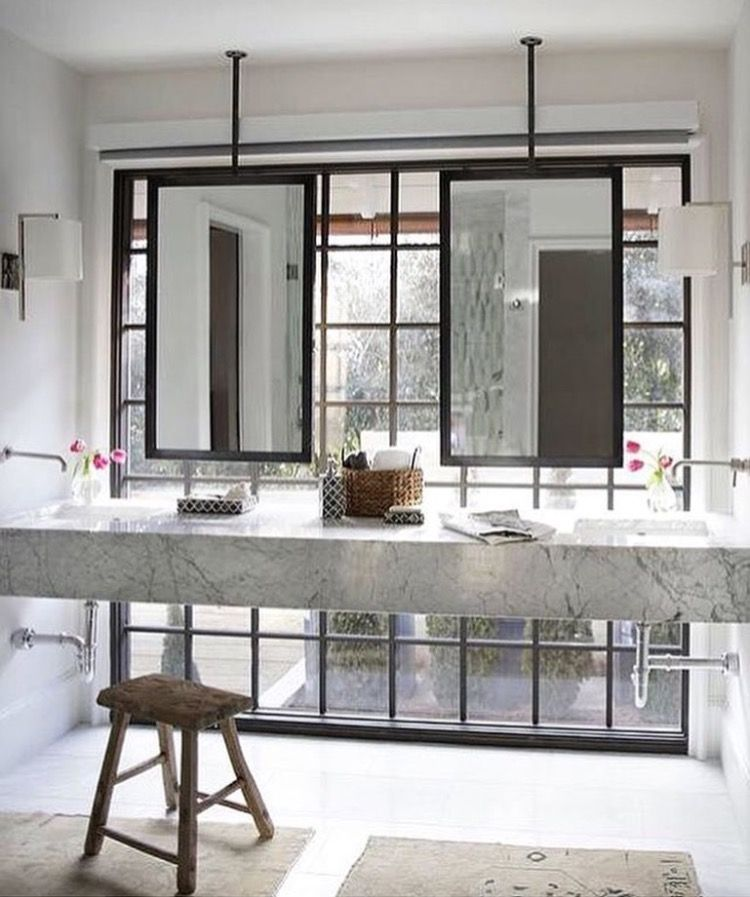 Bathroom Ceiling Mounted Mirror In Front Of Windows