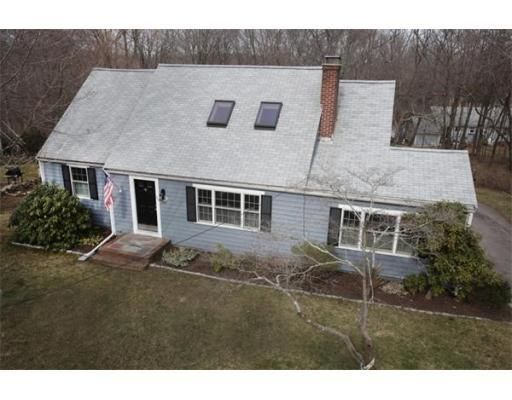 CHARACTER AND CHARM ABOUND IN THIS QUINTESSENTIAL 4 BEDRM CAPE COD STYLE HOME. BOTH SPACIOUS AND GRACIOUS THIS OPEN FLOOR PLAN OFFERS 2 FULL BATHS, HARDWOOD FLOORS, SUNNY NEW KITCHEN WITH STAINLESS STEEL APPLIANCES AND CENTER ISLAND, BUILT INS, FIREPLACE, NEWER WINDOWS, 1 CAR GARAGE AND A COVERED PORCH OVERLOOKING LOVELY BACKYARD. EXCELLENT NORTH SCITUATE LOCATION: WALK TO COMMUTER TRAIN, VILLAGE SHOPS, COFFEE, CONSERVATION TRAILS AND PLAYGROUND OR JUST STROLL TO MINOT BEACH ON YOUR BIKE.