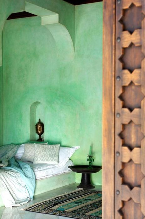 Moroccan inspired bedroom - stunning green wash walls, cute in-built lamp nook & beautiful solid timber door.