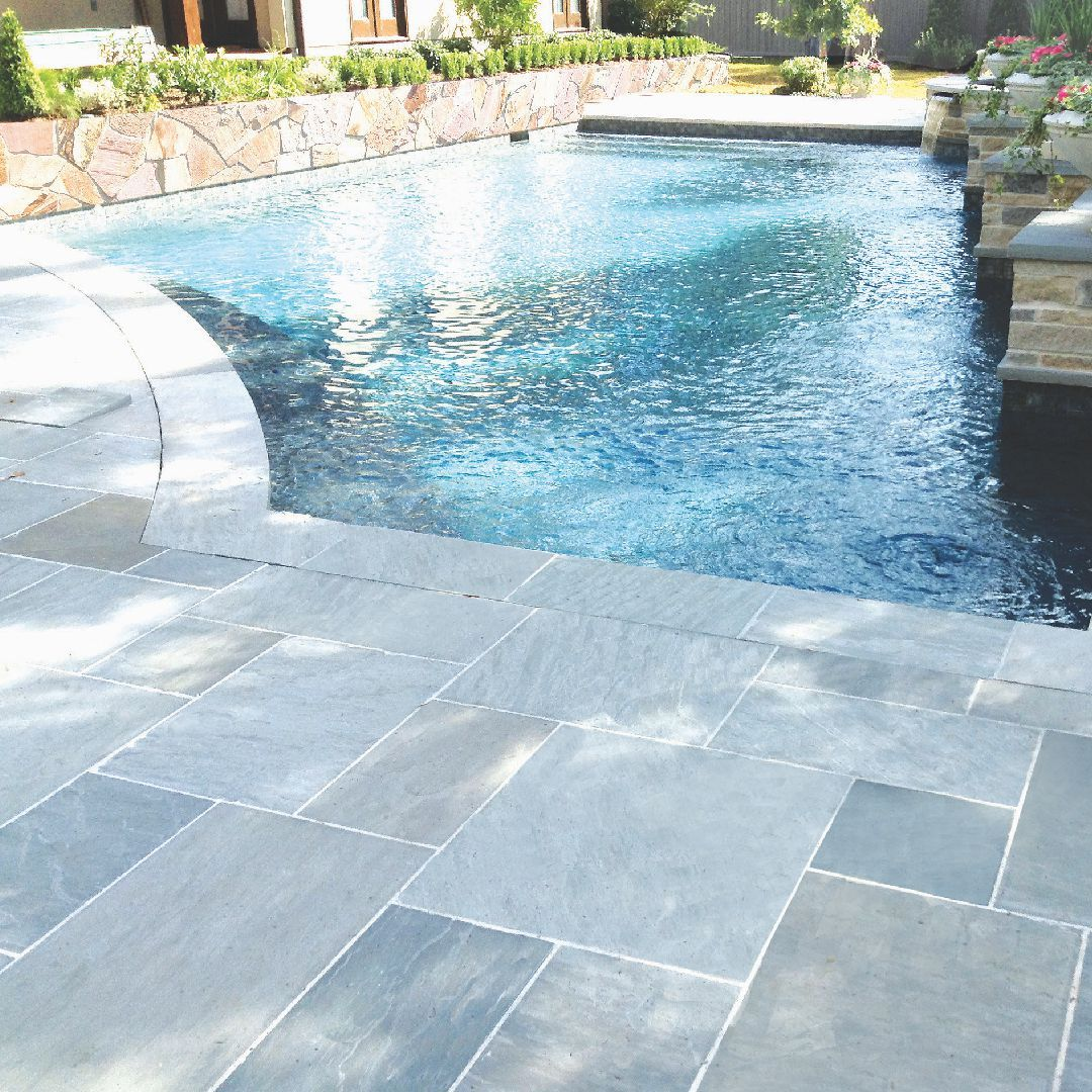 Pave The Pool Deck With The Natural Stone Floor Here The Beautiful Pearl Grey Pattern Looks Alluring Terrazzo Flooring Unique Flooring Natural Stone Flooring