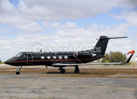 Black jet airplane — Foto de Stock #11659093