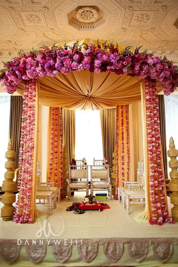 Corner of tent have garlands and flower bouquet garlands as purple mandap floral mandap wedding alter chuppah round mandap by floralia decorators junglespirit Images