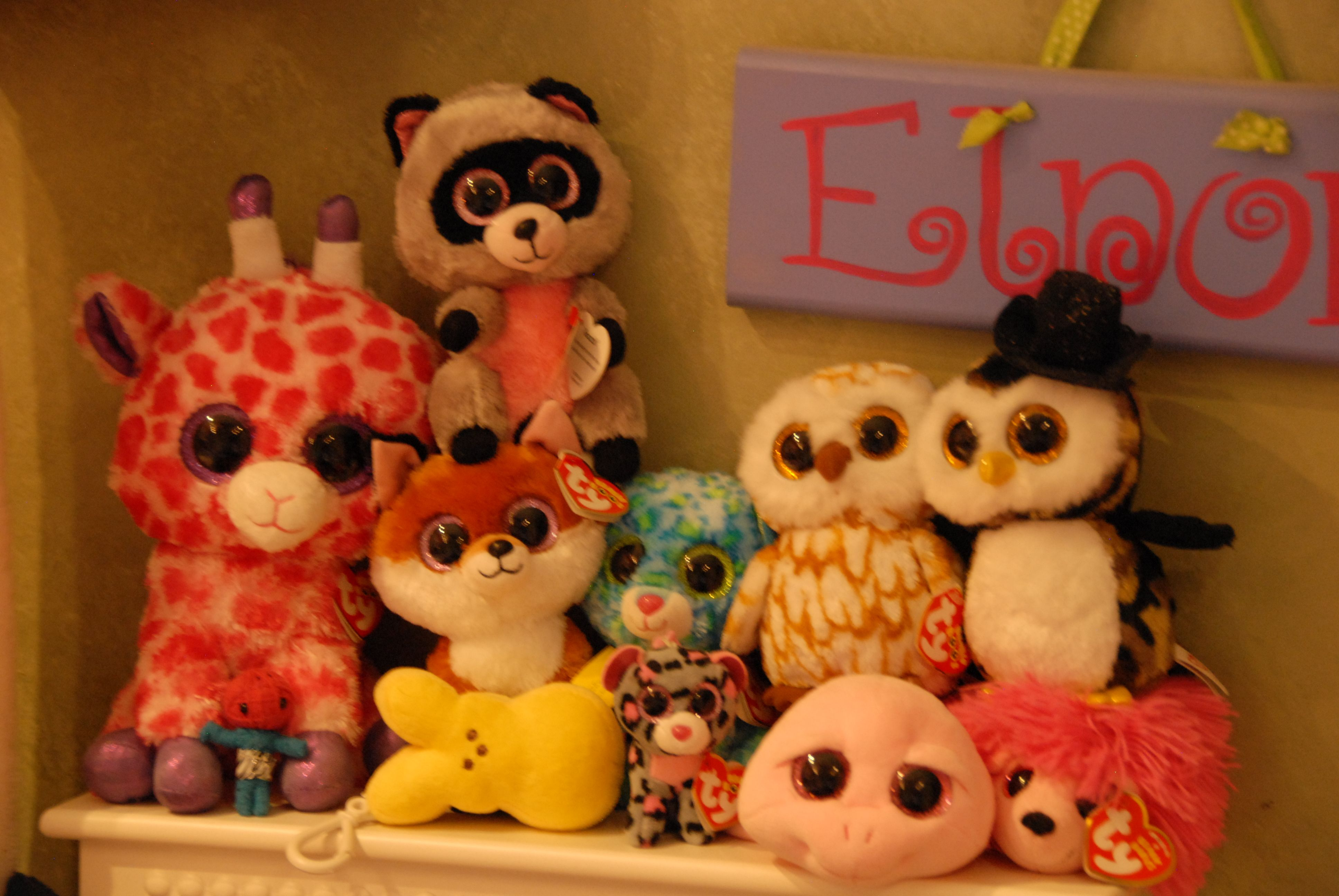 these are some of the big eyed stuffed animal that i own. i have 57 in total!