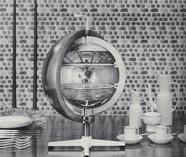 Oven in the Round. Portable oven, by designer Greta Magnusson Grossman, is intended for broiling and baking at the table, on the patio, or in the kitchen. Round half-spheres can be moved in either direction to open or close the oven. Cooking would be by fast radiant heat. Devices such as this point the way to new informality in the home.