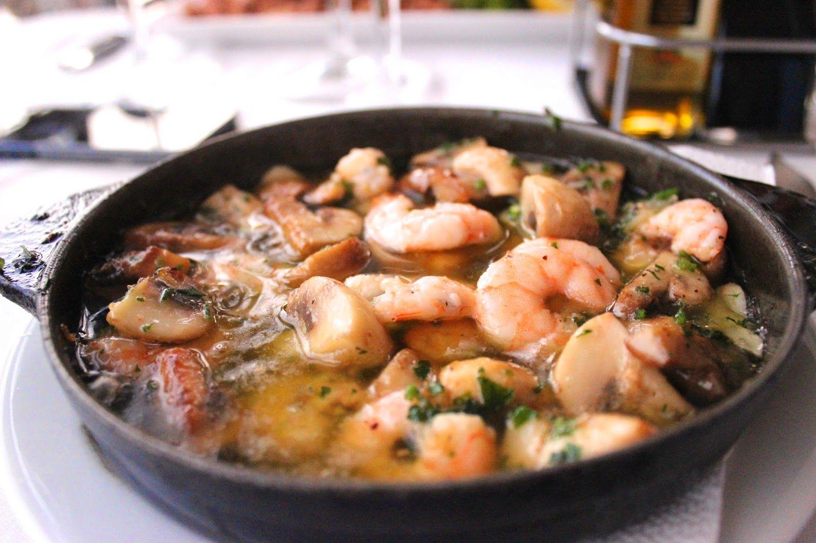 Freshly caught prawns and mushroom in a sizzling garlic oil.