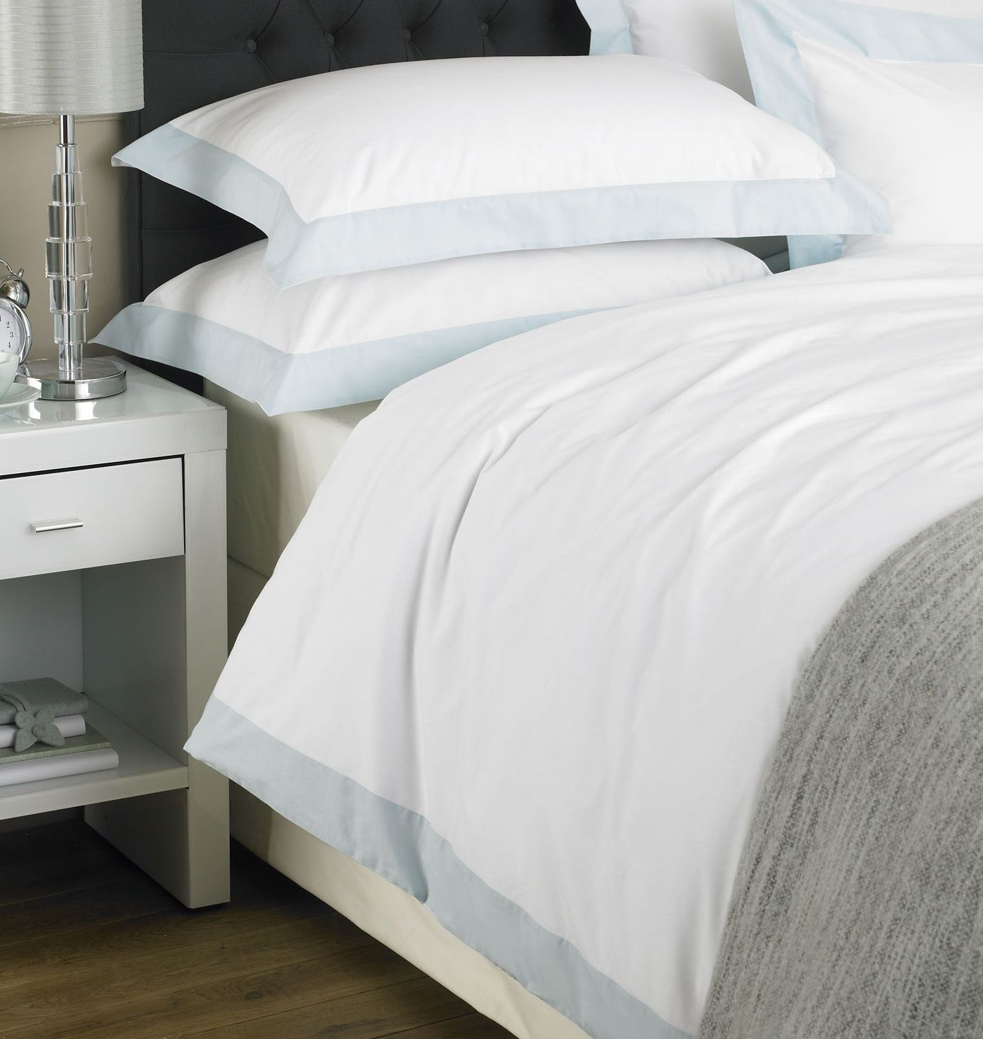 Chic bedding with a duck egg blue trim. http//www