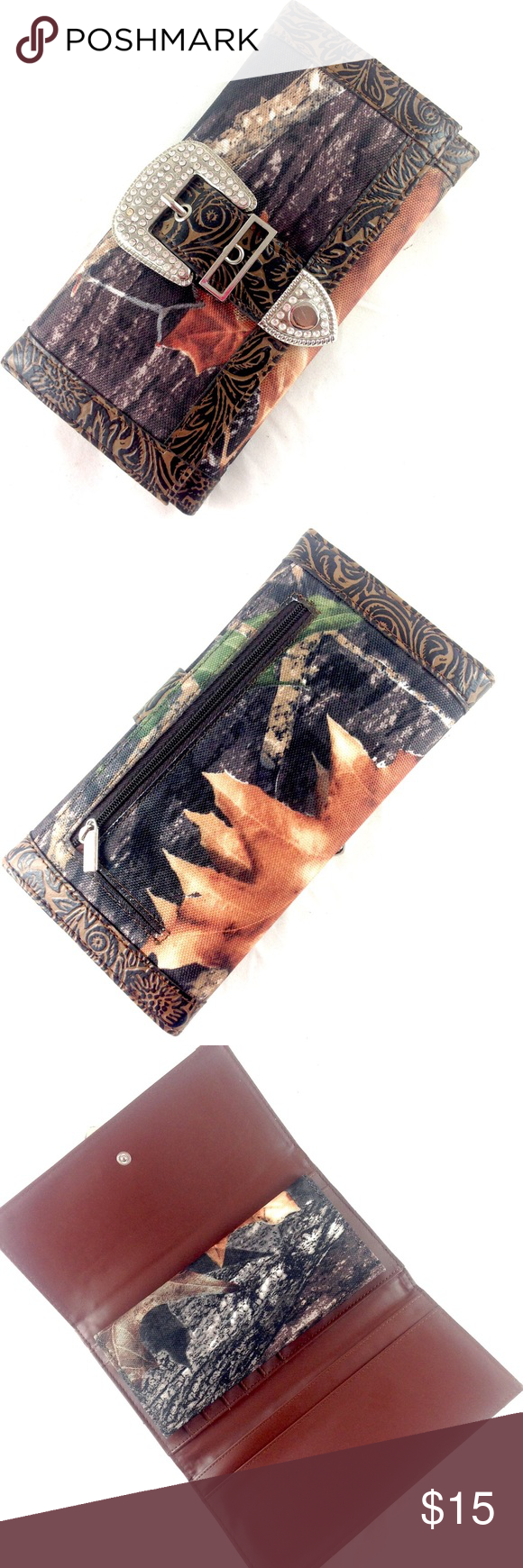 """✔️🆕 Camouflage Rhinestone Buckle Wallet NWOT New without tags. Boutique camo canvas wallet trimmed in tooled brown faux leather. Trifold. Decorative rhinestone buckle on front. Snap closure. Removable checkbook cover.  Places for cards, cash and coins.  8 X 4 X 1"""".                  🔹Please ask all questions before you purchase! I'm happy to help! 🔹Sorry, no trades or holds 🔹Please, no lowball offers 🔹Please use Offer Button! 🔹Bundle for best prices! Boutique Bags Wallets"""
