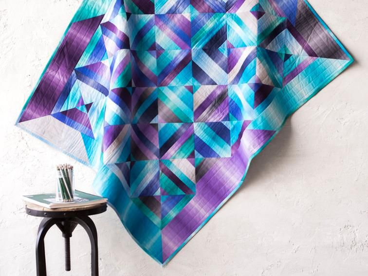 A precut-friendly pattern with seamless blends of jewel tone hues.