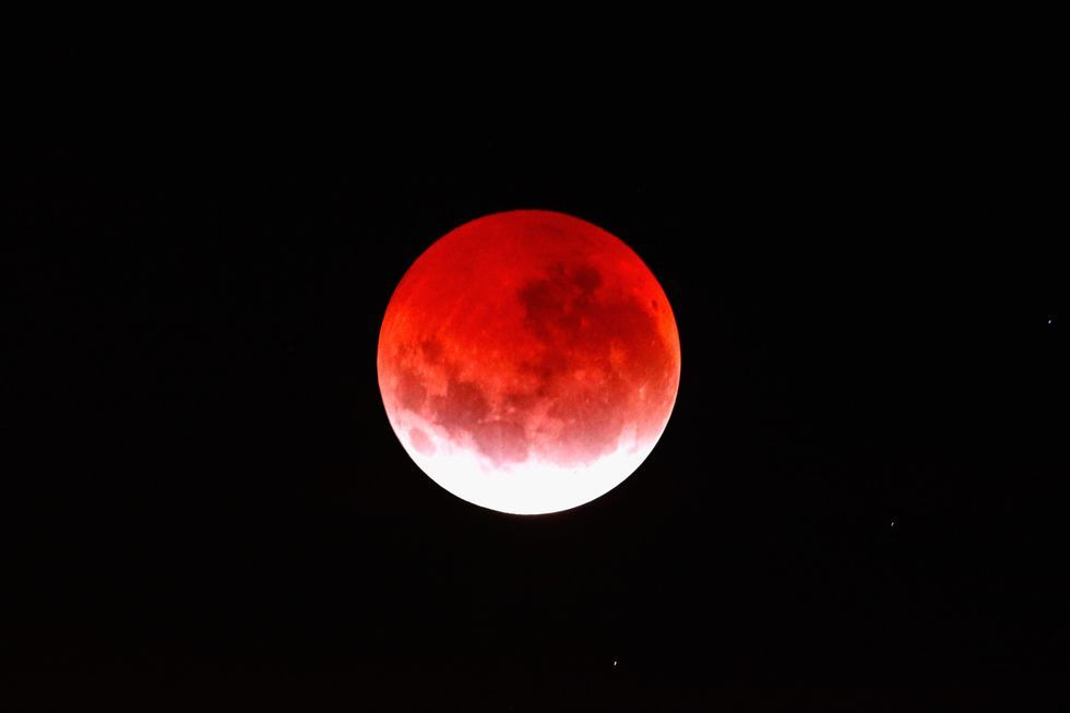 A blood red moon lights up the sky during a total lunar eclipse on April 4, 2015 in Auckland, New Zealand. The shortest total lunar eclipse, or 'blood moon', of the century will last just a few minutes.