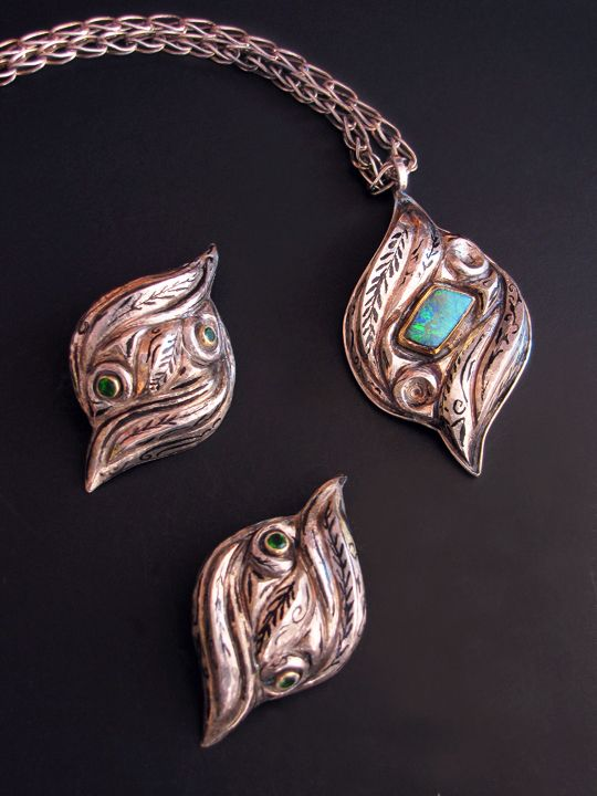 """Flourished I  High relief Eastern repoussé from acid etched copper clad silver pendant on a Roman chain   22K gold, sterling, fine silver, Koroit opal   pendant: 2-1/2 long x 1-1/2 wide x 7/16"""" high, chain adjustable to 19"""" long  © 2012, V. Lansford    Flourished II  High relief Eastern repoussé from acid etched copper clad silver earrings  22K gold, sterling silver, fine silver, chrome diopside  earrings: 2 long x 1 wide x 3/8"""" high  © 2012, V. Lansford"""
