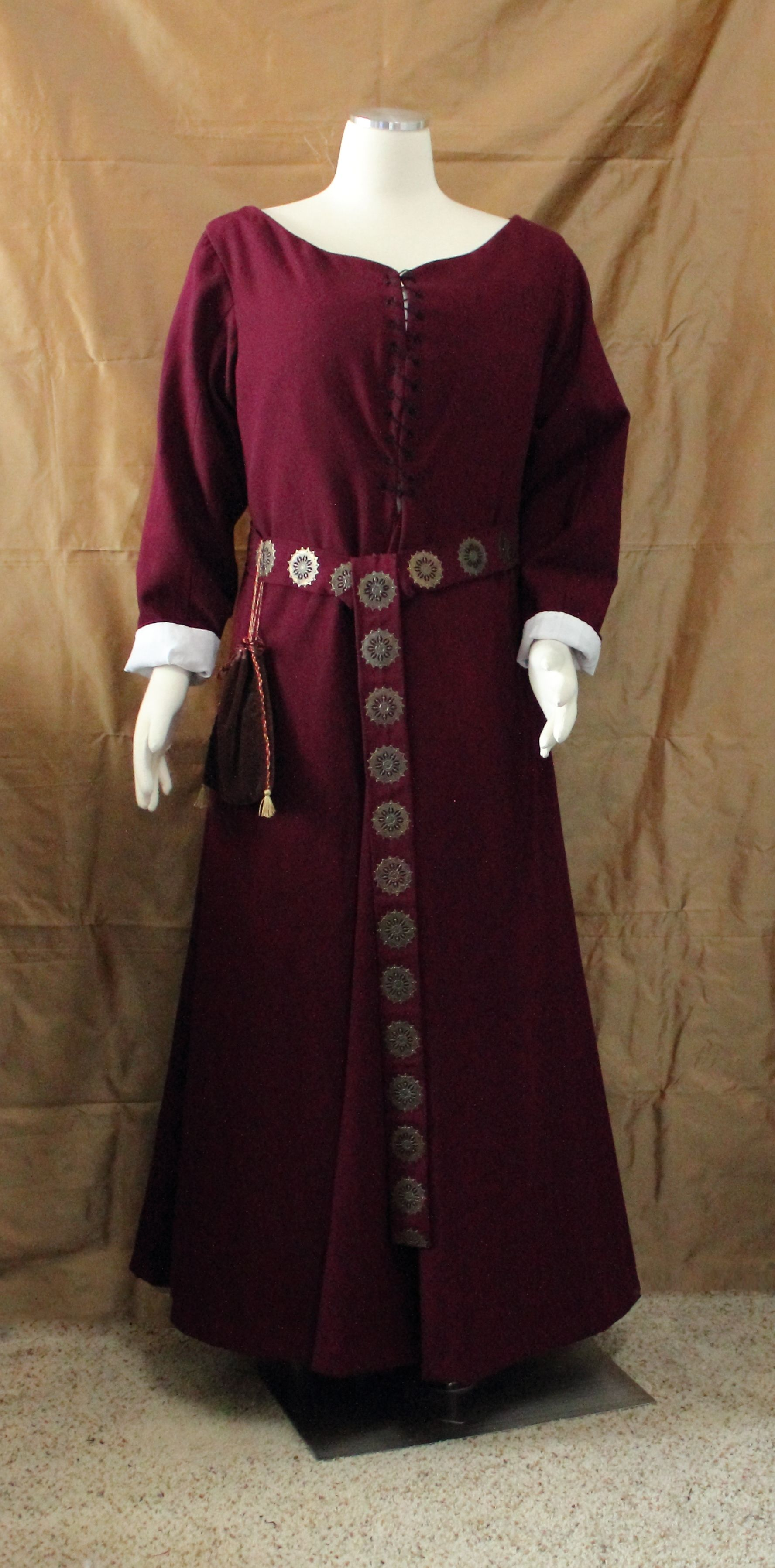 14th century kirtle or fantasy gown depending on the accessories.
