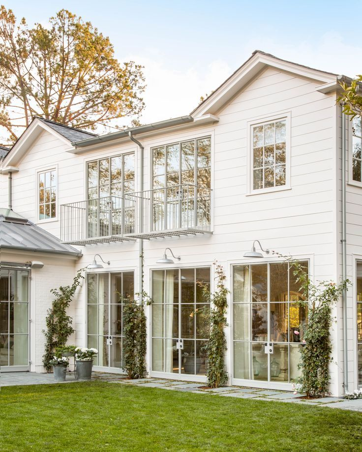 This home is GORGEOUS! Lots of windows, fresh white paint, exterior ...