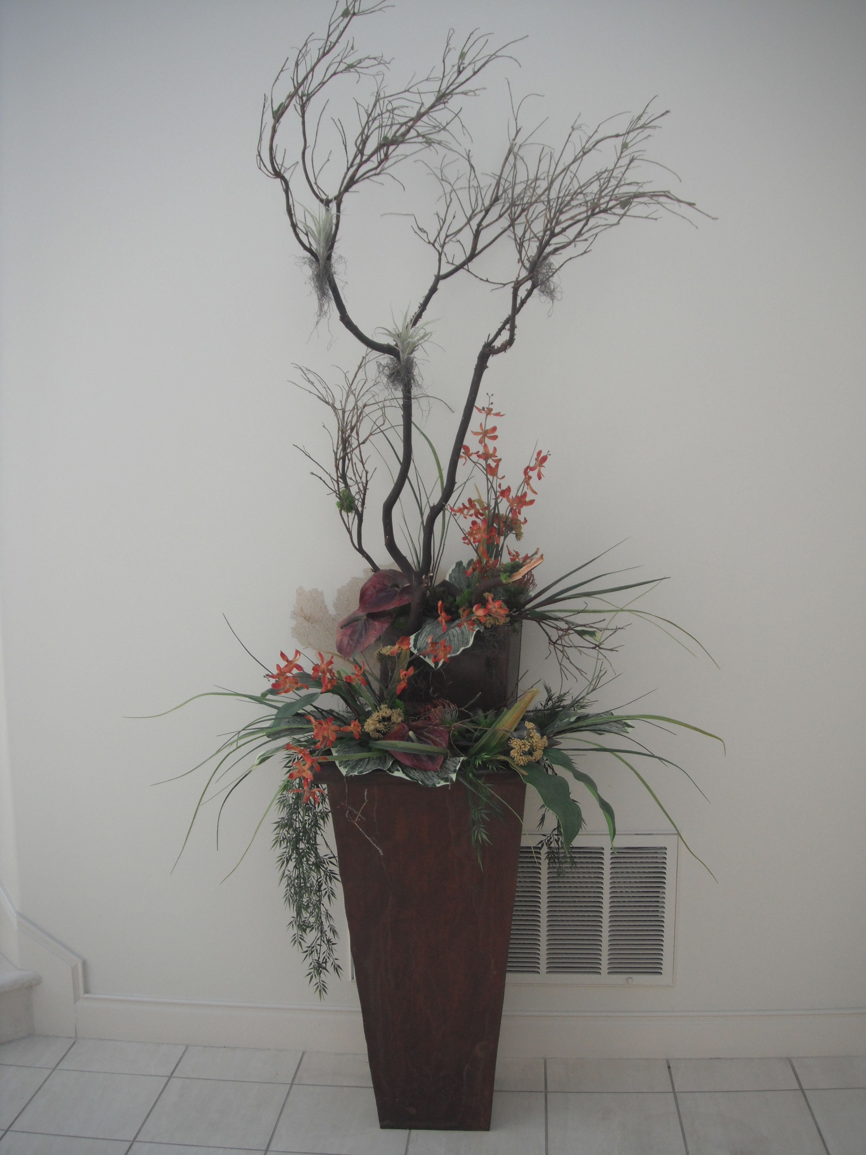 Manzanita is a wonderfully natural design structure to use in larger creations.  I also enjoy adding smaller containers to continue the visual interest.