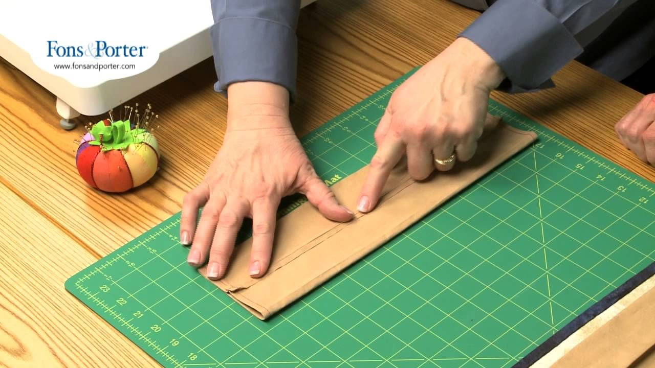 www.FonsandPorter.com: In this video, we show you how to add a hanging sleeve to your quilt is easy. Follow these easy guidelines to preparing a hanging slee...