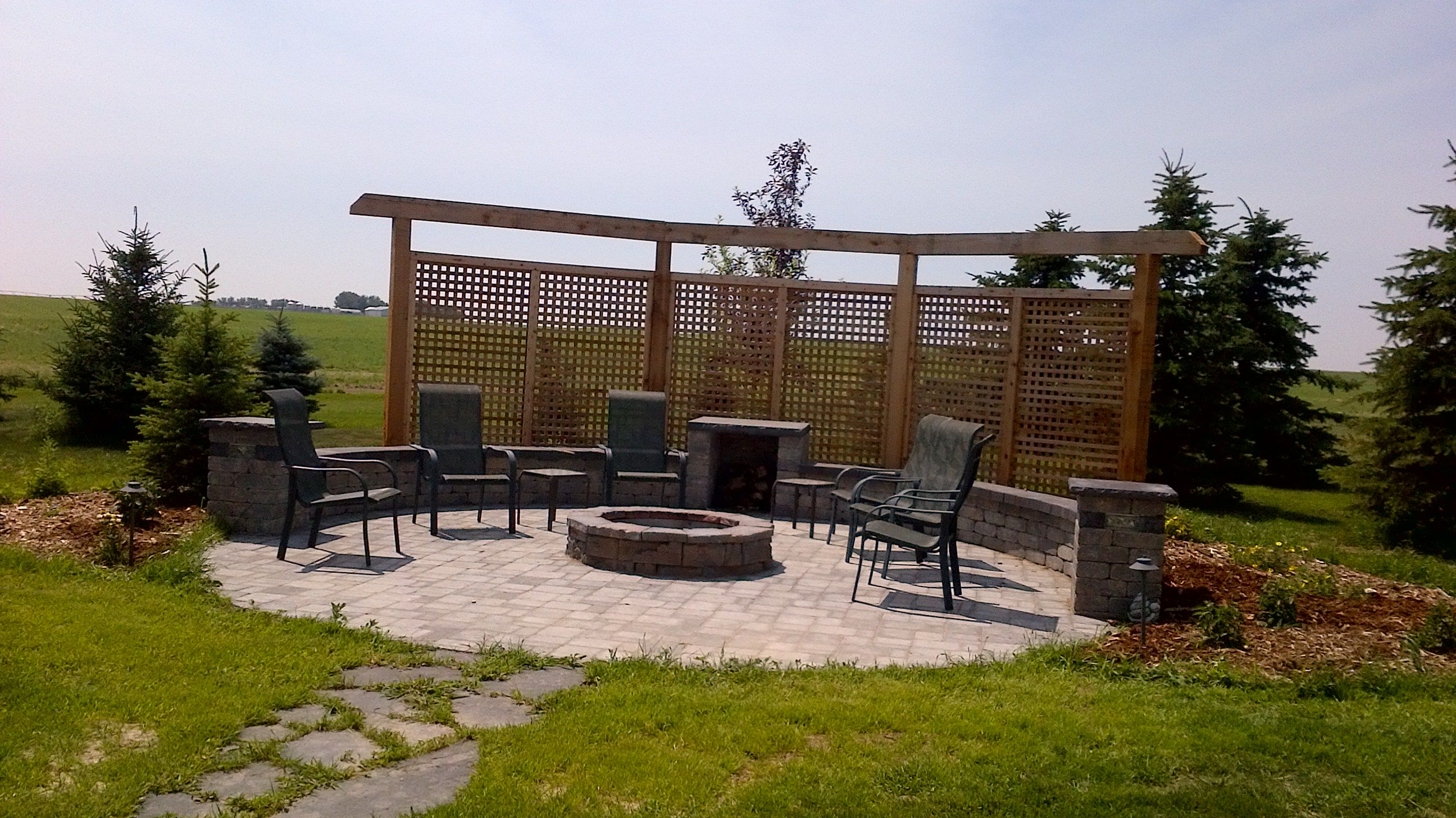 Amazing Fire Pit Area With Cedar Wind Wall And Seating Wall And Pillars Surrounding The Pad Van Tryp Residence Outdoor Rooms Backyard Backyard Privacy