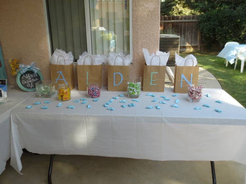 Gifts For Baby Shower Game Winners With Candy Scattered Around