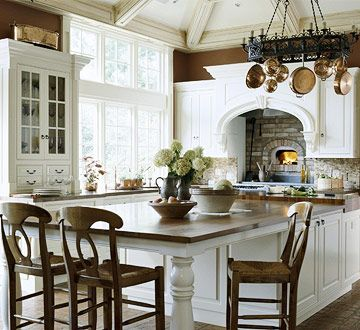 I love everything about this kitchen!  So pretty and functional!  Love the seating area!
