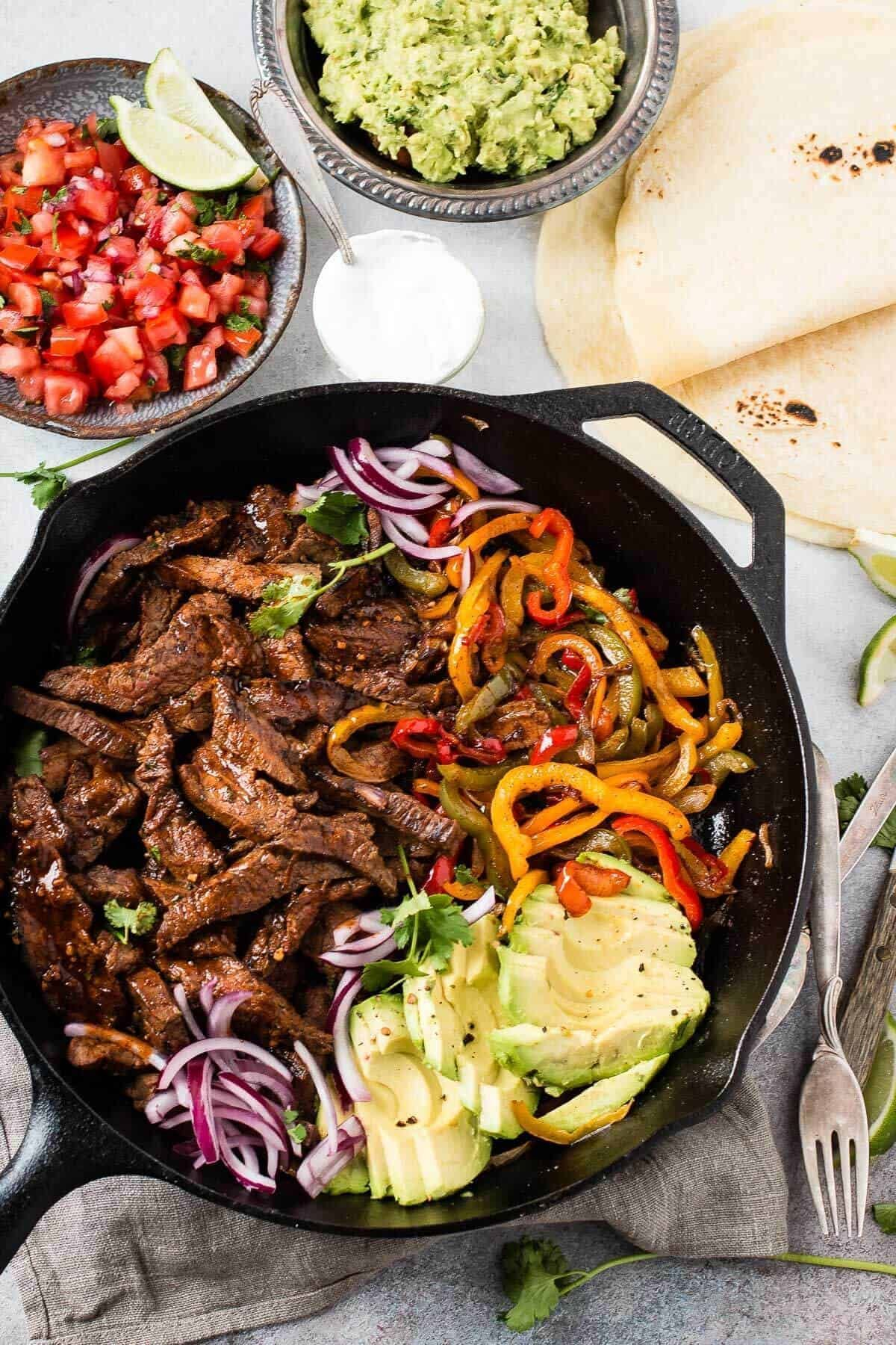 Our Favorite Steak Fajitas Marinade #steakfajitarecipe The secret to the best steak fajitas recipe is all about the marinade. You'll need three different citrus juices... ohsweetbasil.com #beeffajitamarinade Our Favorite Steak Fajitas Marinade #steakfajitarecipe The secret to the best steak fajitas recipe is all about the marinade. You'll need three different citrus juices... ohsweetbasil.com #beeffajitarecipe