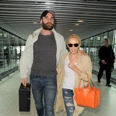 EXCLUSIVE Kylie Minogue and fiance Joshua happily walk arm in arm through Heathrow