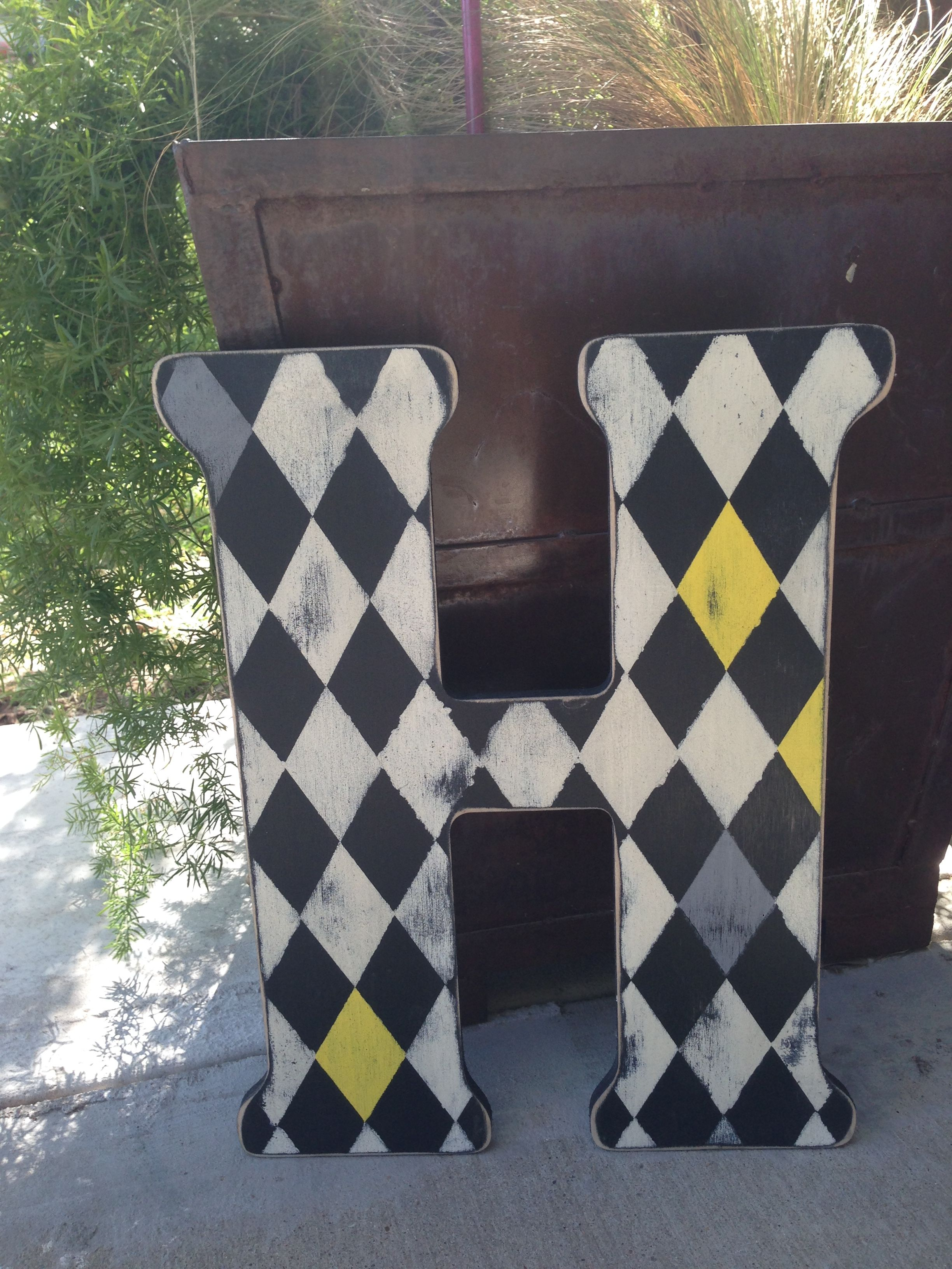 Wooden letter painted with harlequin/diamond design. I