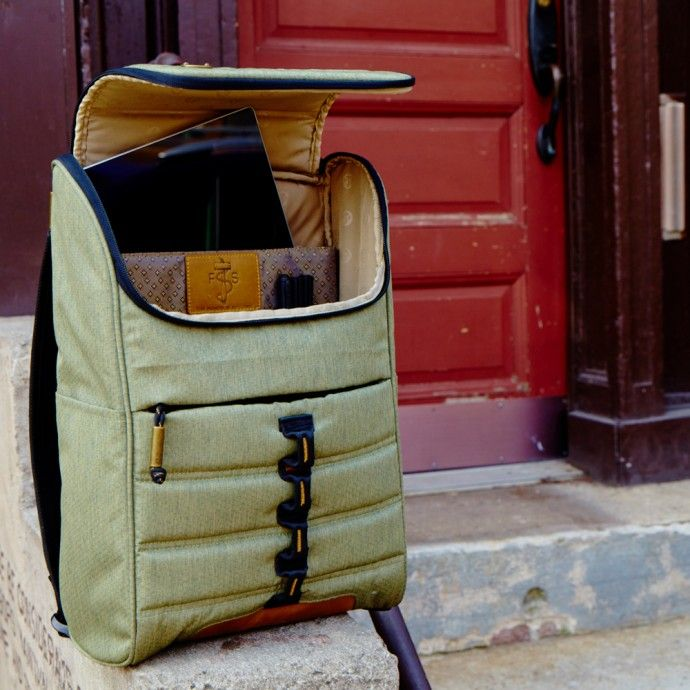 """A staple design in the Focused Space collection - the FS version has a little extra """"leg room"""". The carrier bag that commands excellence and keeps your tech safe through everyday excursions.  Dimensions: 18""""(H) x 11""""(W) x 5""""(D)<br><br>Features:<br>Camo Canvas<br>Reverse tape top load zip closure (the """"hatchback"""" zip of bags)<br>Padded 15"""" laptop compartment<br>Multiple interior pockets for top tier organization<br>Quick access front zip pocket<br>Quilted back panels with single piece…"""