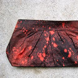 Use bleach to create a perfect splatter-paint inspired clutch!