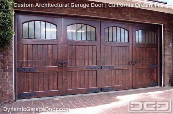Wood Garage Door With Speakeasy Grills And Decorative Clavos