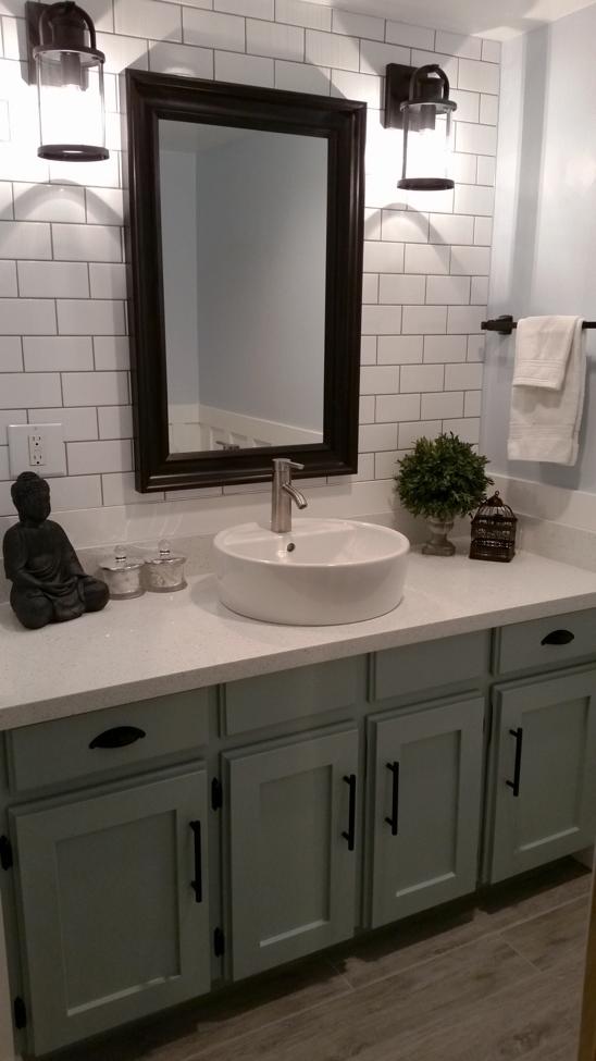 Photo of Farmhouse bathroom. blue. white subway tile backsplash. Farmhouse light fixtures…