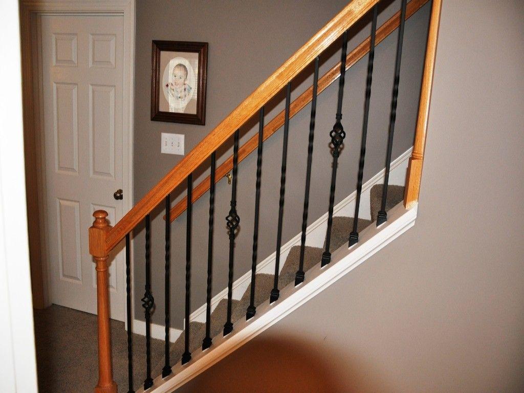 Easy rod iron stair railing choosing rod iron stair for Iron stair railing