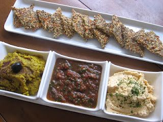 Home made vegetable spreads with flax and carrot crackers
