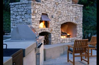 outdoor pizza oven. This is what I need, except the fireplace needs to be open on both sides so it can also add coziness to the (imaginary) hot tub area which will be behind it.