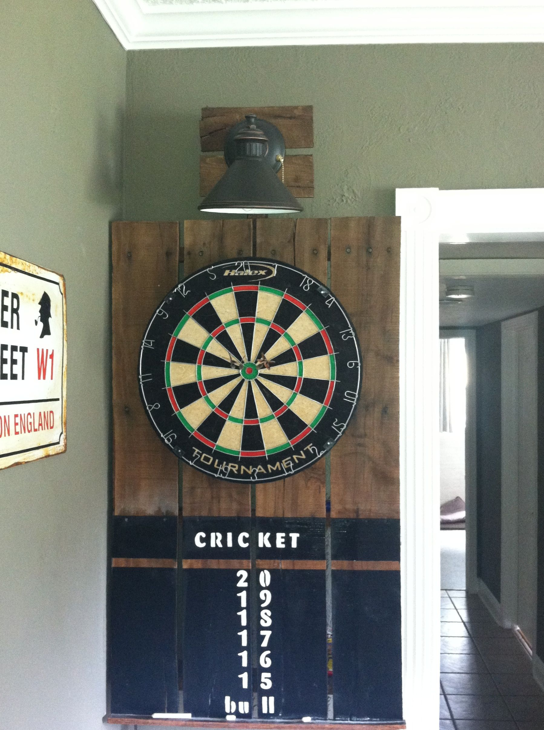 Dartboard made from a pallet and outdoor light