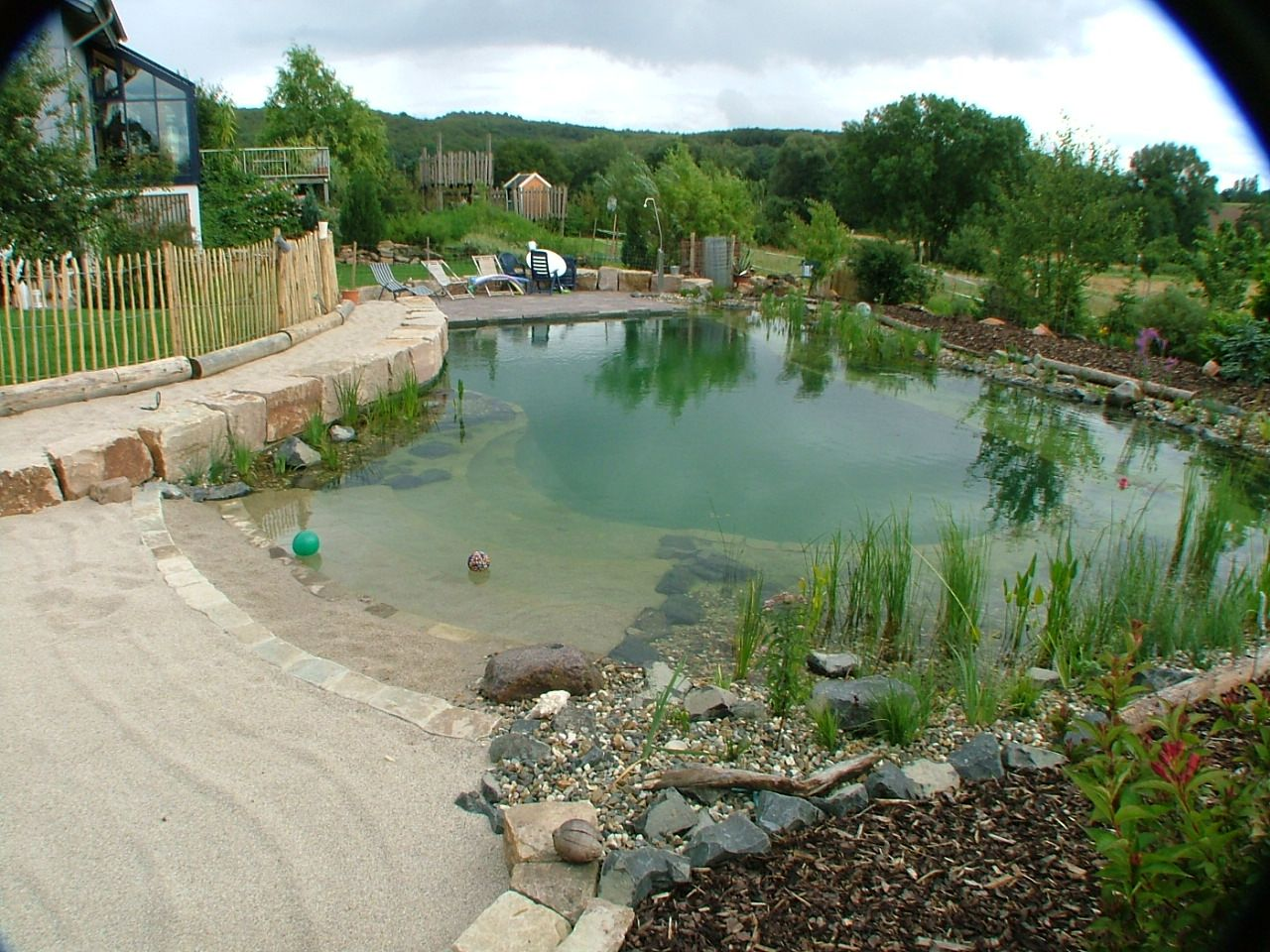Natural Swimming Pool with a Beach Entrance Swimming