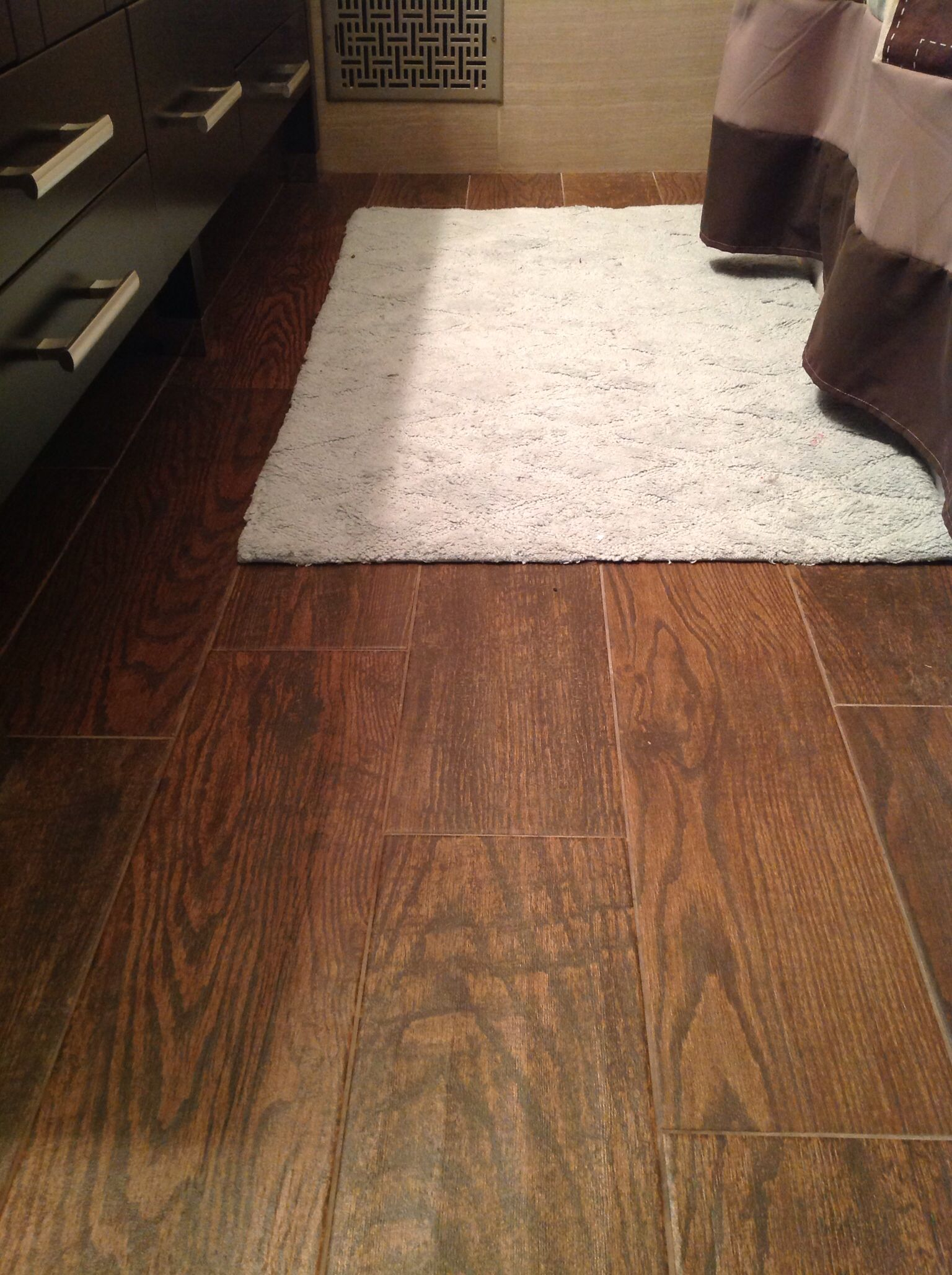 Tile flooring that looks like hardwood. You can find it at ...